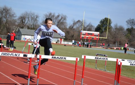 Track team defeats county rivals at conference meet