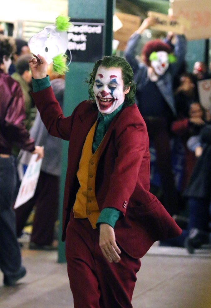 The joker in the street during one of the scenes in the movie.