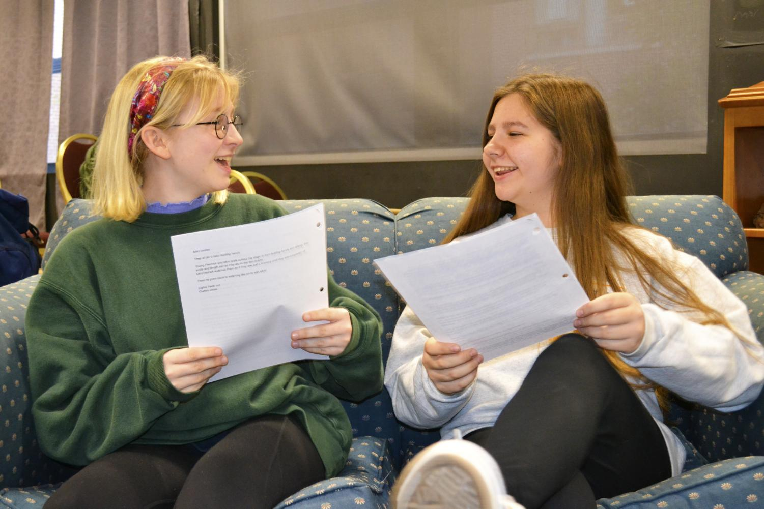 Macy Major and Abby Mesick discuss ideas about their scripts.
