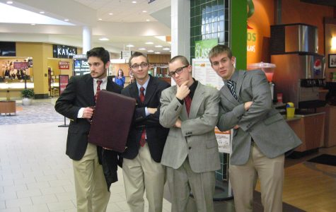 Seniors Colin Steves, Kevin Sanford, Casey Adamowicz and junior Brady Burr pose and prepare for DECA's regional competition at the Apple Blossom Mall.