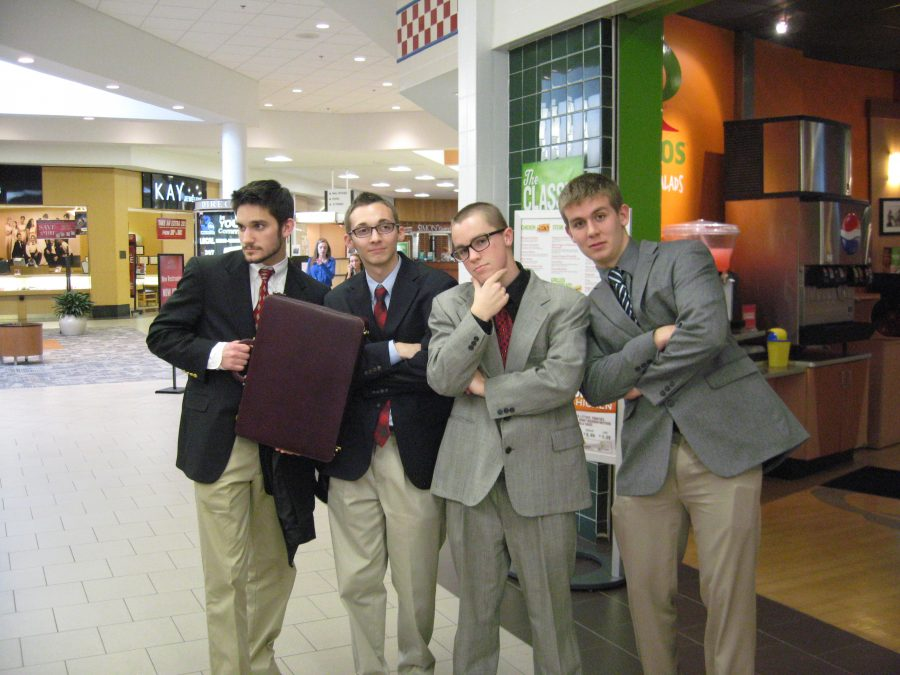 Seniors+Colin+Steves%2C+Kevin+Sanford%2C+Casey+Adamowicz+and+junior+Brady+Burr+pose+and+prepare+for+DECA%E2%80%99s+regional+competition+at+the+Apple+Blossom+Mall.