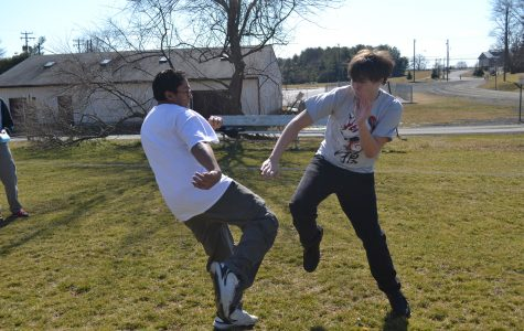 """Junior Ian Soule and senior Sergio Ribeiro demonstrate their martial arts outside. """"It helps you stay fit and react quickly,"""" Ribeiro said. """"It really promotes self discipline."""""""