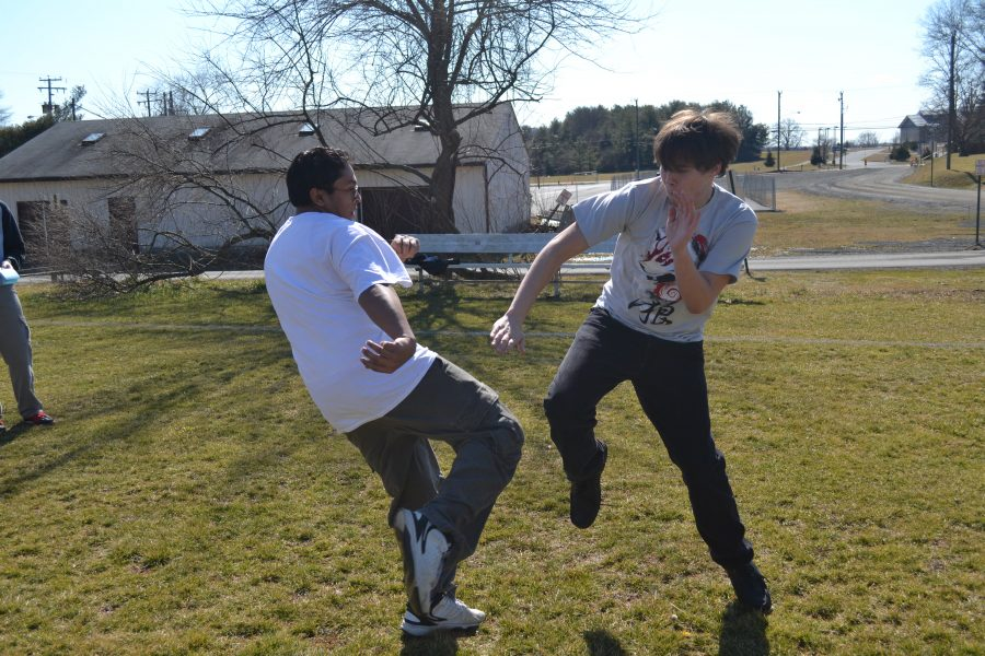 "Junior Ian Soule and senior Sergio Ribeiro demonstrate their martial arts outside. ""It helps you stay fit and react quickly,"" Ribeiro said. ""It really promotes self discipline."""