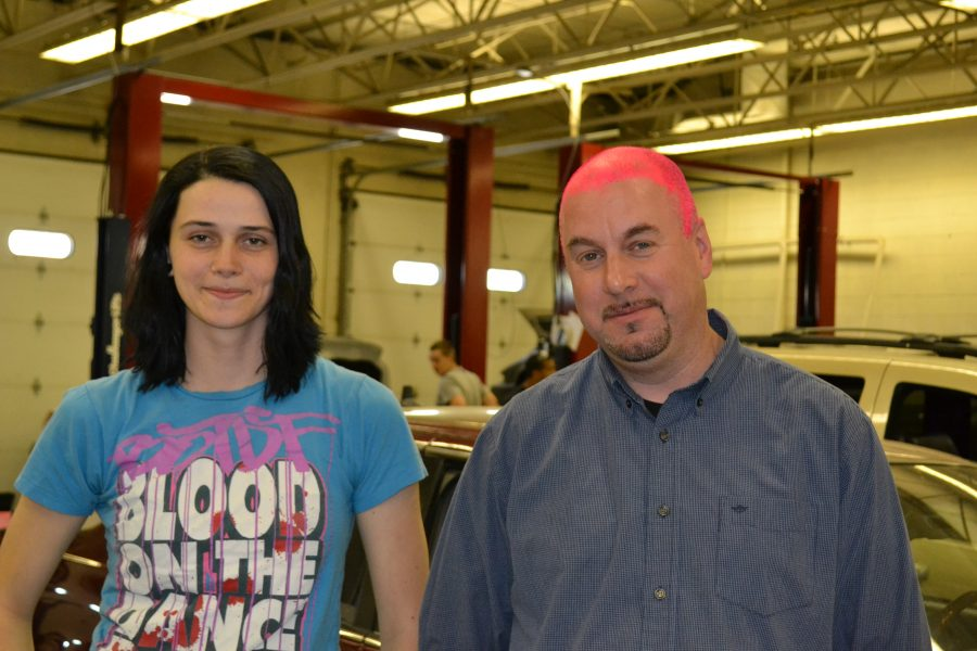 Alex+Wolfe+stands+with+her+pink+haired+automotive+teacher%2C+Scott+Freeman.+The+two+made+a+bet+that+if+Wolfe+placed+in+the+national+automotive+competition%2C+he+would+paint+his+head+pink.