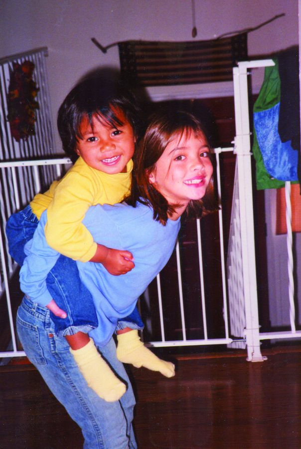 A young senior Greer Blanchette gives her young Samoan sister a piggy-back ride.