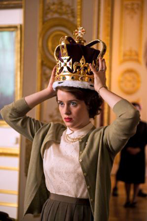 Claire Foy portrays Queen Elizabeth II in the Netflix original series The Crown. The show features a soundtrack that adds suspense and awe to a dramatic depiction of the Queen's personal life.