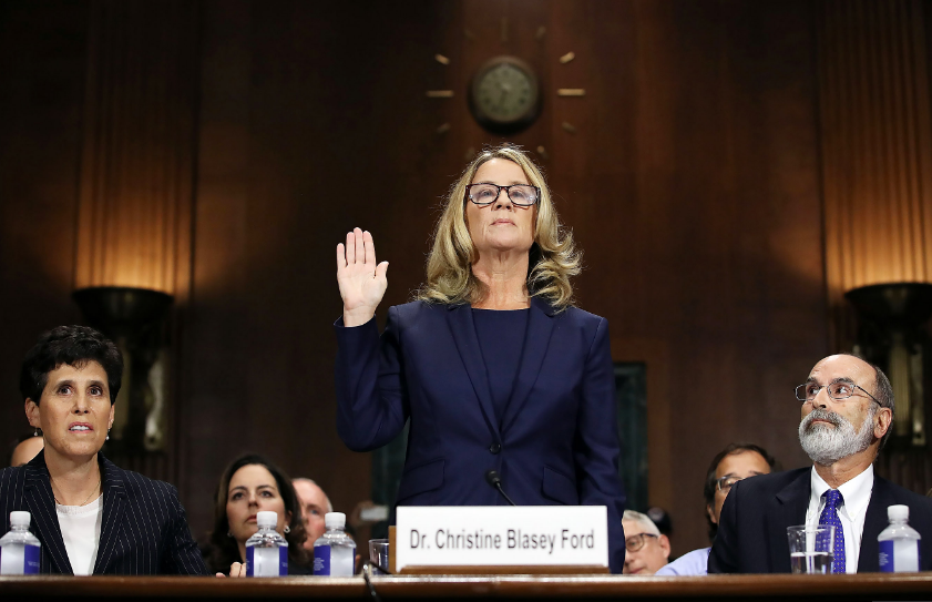Christine Blasey Ford swears in during he testimony in front of the Senate Judiciary Committee.