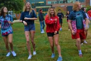 Students are dressed to in red, white and blue while dancing with Madame Goepper in French class.