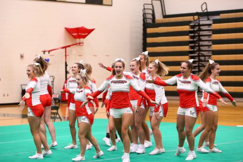 The team cheers for the judges at the Kettle Run Invitational.