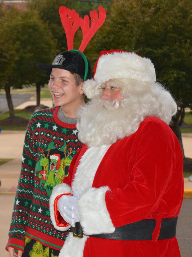 Santa greets students outside the main entrance of the school.