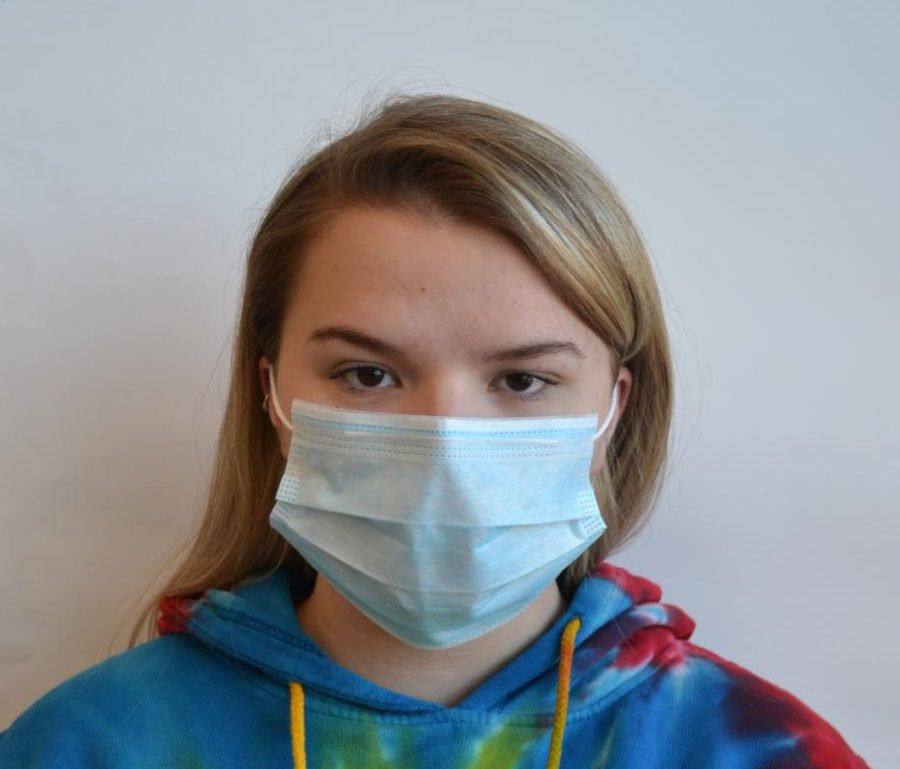 Grace+Hinkler+models+the+mask+that+many+are+wearing+to+take+precautions+against+catching+the+whooping+cough.+