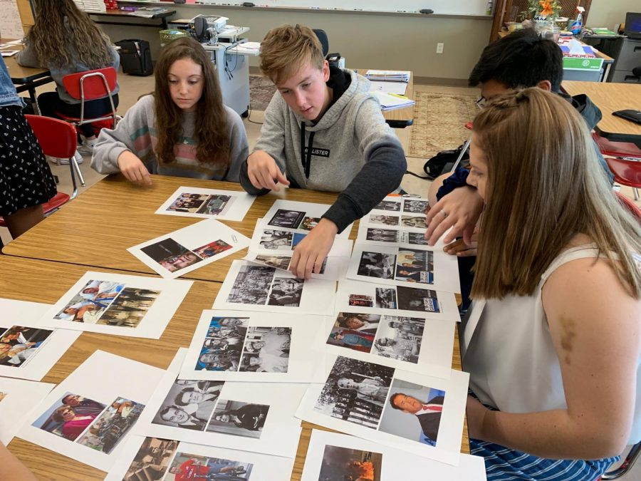 Junior Jacob Timko helps team move around pictures describing the life of Arnold Schwarzenegger for a classroom activity.