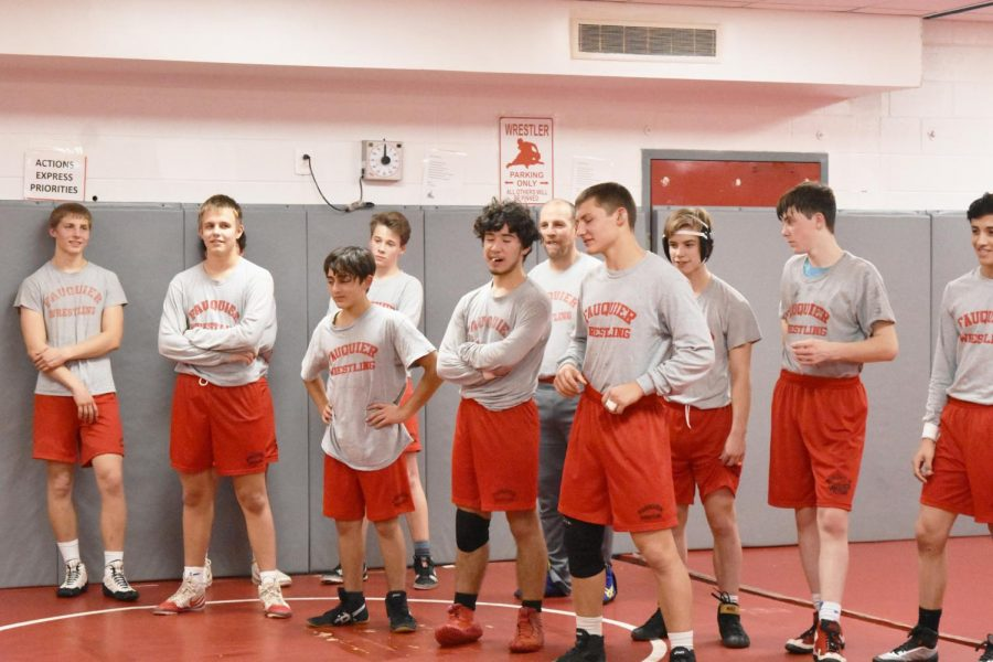 The wrestling team break a sweat as they train hard for upcoming competitions.