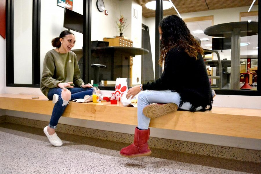 Because of the no eating rule, Tatiana Baker and Dayona Thomas sat outside the Falconer Room to eat their Chick-fil-A.