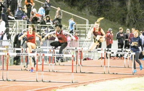 Alyssa (left) and Stephanie (right) compete against each other in the hurdle race.
