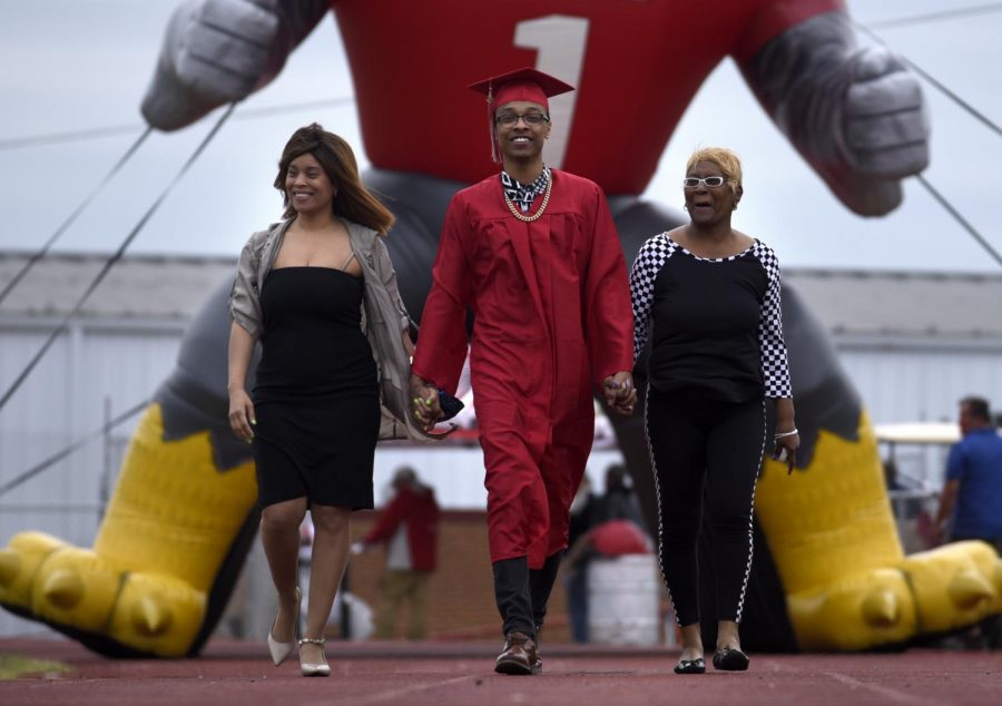 Each senior's graduation experience was made special through new ceremony additions such as walking under the inflatable falcon with their parents to well-known traditions such as walking across the bridge and onto the stage.