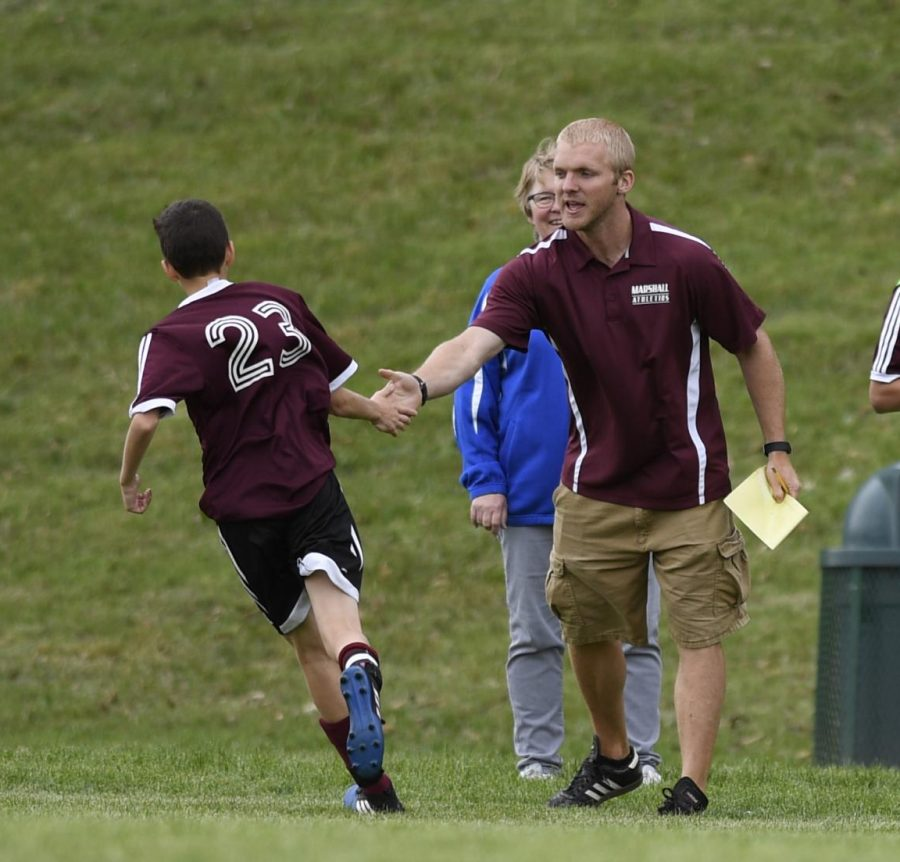 Congratulating a student during a Marshall Middle School Soccer game where Davenport used to coach.