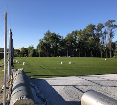 The tennis courts undergoing renovation to become the new Falcon Sports Spot, turf field.