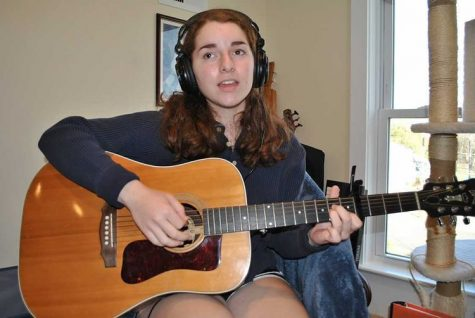 Niamh Kierans practicing with her recording equipment.