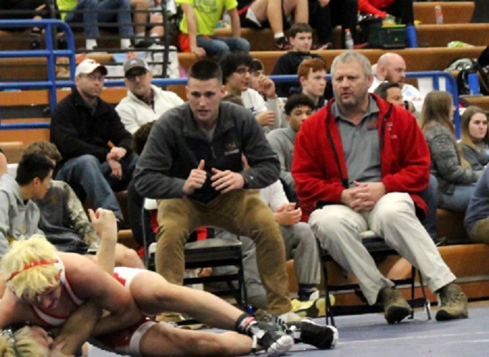 Encouraging from the sidelines, Chad Hoffman is supporting the Falcons' wrestling team by doing what he loves, coaching.