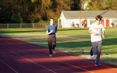 Fauquier High School athletes running on the track.