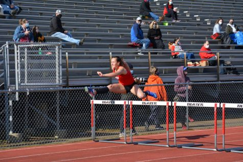 Junior Alyssa Robson leaps over a hurdle at Regionals representing FHS.