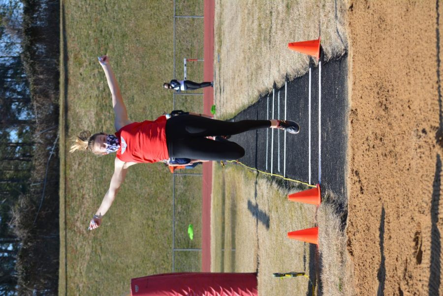 Senior Stephanie Robson flies in mid-air in her long jump attempt at Regionals for FHS.