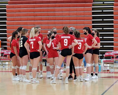 The Varsity Girls Volleyball team breaks to discuss strategy and regroup before set two against Kettle Run High School.