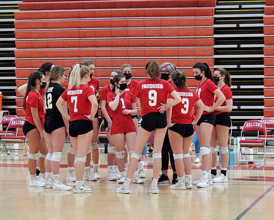 The+Varsity+Girls+Volleyball+team+breaks+to+discuss+strategy+and+regroup+before+set+two+against+Kettle+Run+High+School.
