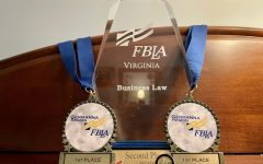 A cumulative array of awards fills senior Rachel Singleton's shelf, bringing back memories of past FBLA competitions.