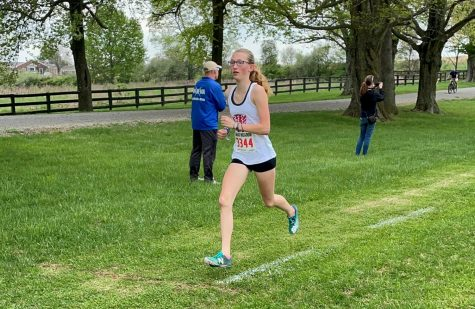 Cassidy Scott takes the lead in the Regional cross country meet at Morven Park.