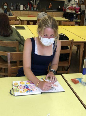 Natalie in Art III 3-D working on her sketchbook.